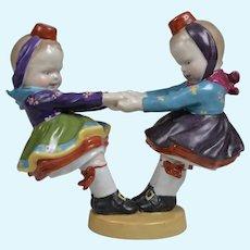 Gebruder Heubach Glazed Figurine of Joyful Dancing Girls