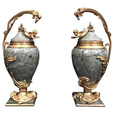 Pair of French Ormolu Mounted Marble Urns with Cherubs