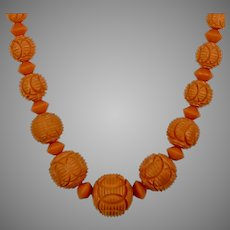 Art Deco Carved Coral Bakelite Bead Necklace