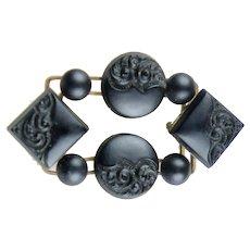 Victorian Carved Matte Black Glass Mourning Brooch
