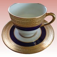 Gilded Royal Doulton Demitasse Cup & Saucer