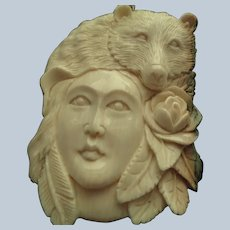 Hand-Carved Bone Pendant of Lady with a Bear