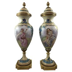 Pair of 19th Century Sevres Porcelain Urns with Women and Cherubs Signed, French