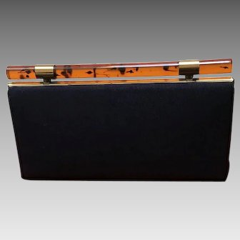 Vintage Navy Clutch with Sleek Design and Lucite Rod Clasp