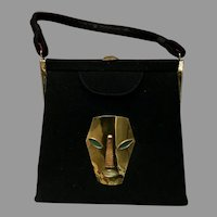 Vintage Handbag with Strange Metal Face Appliqué