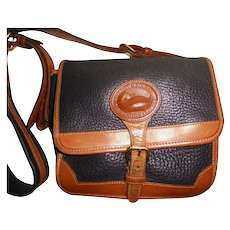 Luxurious Authentic Dooney & Bourke Shoulder Bag Black / Deep Navy with British Tan Trim Made in USA Pebbled Leather Brass Fob