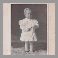 1899 Mat Photograph of Identified Child with Bell