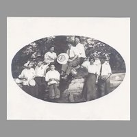 Real Photo Postcard of Group Advertising and Camera