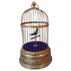 Antique French bird automaton in brass cage by Bontems 1907