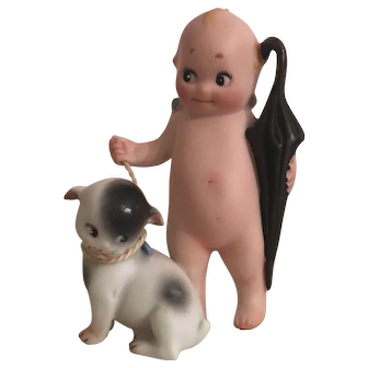 Adorable antique Kewpie and doodle dog figurine