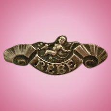 Antique French Silver Cherub Bebe on Ribbon Scroll Pin