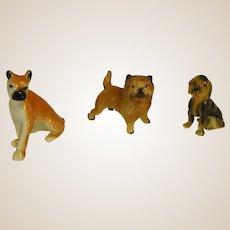 Darling Group of Small Buff Colored Porcelain Dogs