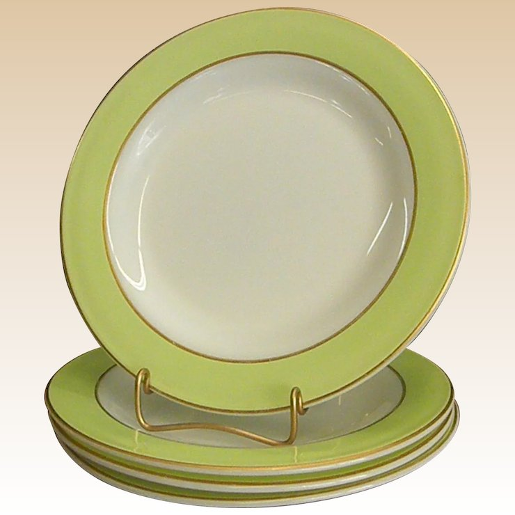 set of pyrex lime green and white with gold trim dinner plates