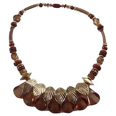 Chunky Faceted Amber Lucite Cone and Leaf Gold tone Statement Necklace