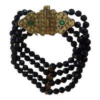 Unusual 4 Strand Black Glass Bead Bracelet Emerald Green Cabochon Brass Butterfly Clasp