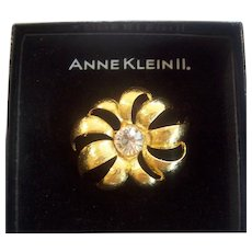 Anne Klein II Gold tone Flower brooch w/ Large Faceted Crystal Clear Center Stone in Box