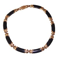 Monet Black Enamel and Gold tone Necklace