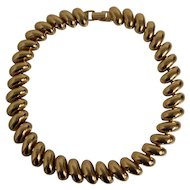 Napier Classic Gold tone Domed Segment Necklace