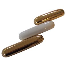 Gold tone and Cream Bullet Shaped Brooch Monet