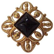 Monet Gold tone Black Lucite Brooch
