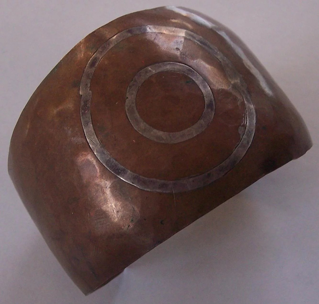 Wide hammered copper mixed metal cuff with silver target