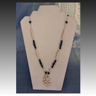 Opera Length Necklace in White Akoya Baroque Salt Water cultured Pearls and Lapis Lazuli Beads