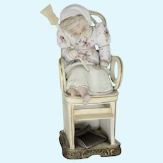 Sleeping Scullery Maid late 19th early 20th Century bisque figurine
