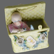 Late 19th early 20th Century Bisque Baby in a Basket.