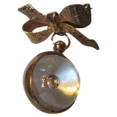 Vintage Mustard Seed Pin in Orb hanging from Bow Pin Brooch