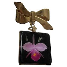 Gorgeous Orchid in Lucite Square hanging from Bow Vintage Brooch Pin