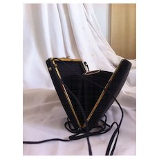 Black satin vintage woman's purse compact with embroidered flower.