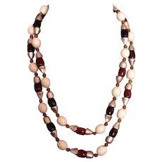 Long vintage necklace carnelian like plastic beads flea market find