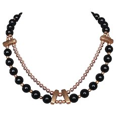 Art Deco style vintage necklace fashioned with black & gold color beads