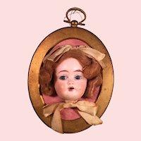 German Doll Face on Oval Frame