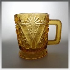 EAPG Small Amber Mug Daisy & Button with V Ornament Beatty/US Glass