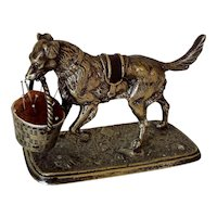 A Victorian Cast Metal Dog Pin Cushion with a Basket