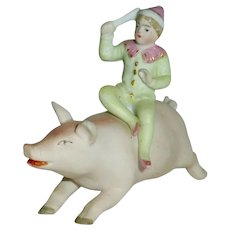 German Boy Clown Riding on Pink Pig