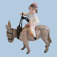 Boy Riding Donkey Nodder Porcelain Figurine