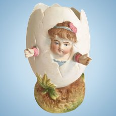 German Girl Hatching from Egg Figurine