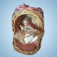 Tiny All Bisque Baby in Wicker Cradle