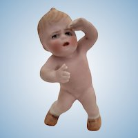 Adorable Heubach Action Baby Figurine