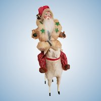 Santa Claus Riding Sheep