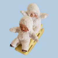 Two Little Snowbabies on a Sled