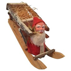 German Santa riding in Wooden Sled Candy Container