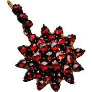 Antique Victorian bohemian garnet flower cluster pendant.