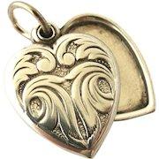 Art nouveau Edwardian sterling silver heart slide locket, charm size.