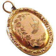 Antique rose gold back and front swallow locket