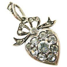 Antique sterling silver paste heart and bow pendant