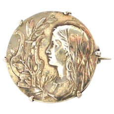 French art nouveau silver lady brooch with lyre and mistletoe, Cecilia, goddess of music.