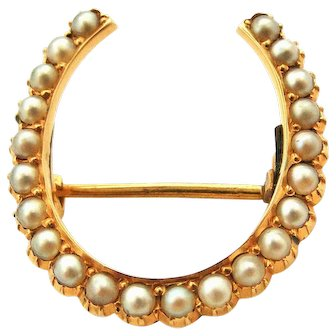 Victorian high carat lucky horseshoe brooch set with natural seed pearls